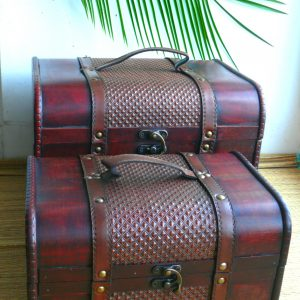Set of 2 dark wooden chests with metal fittings