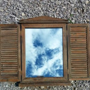 Large shuttered mirror