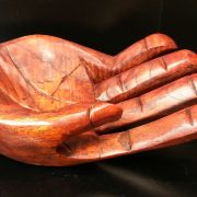 Wooden hand shaped bowl